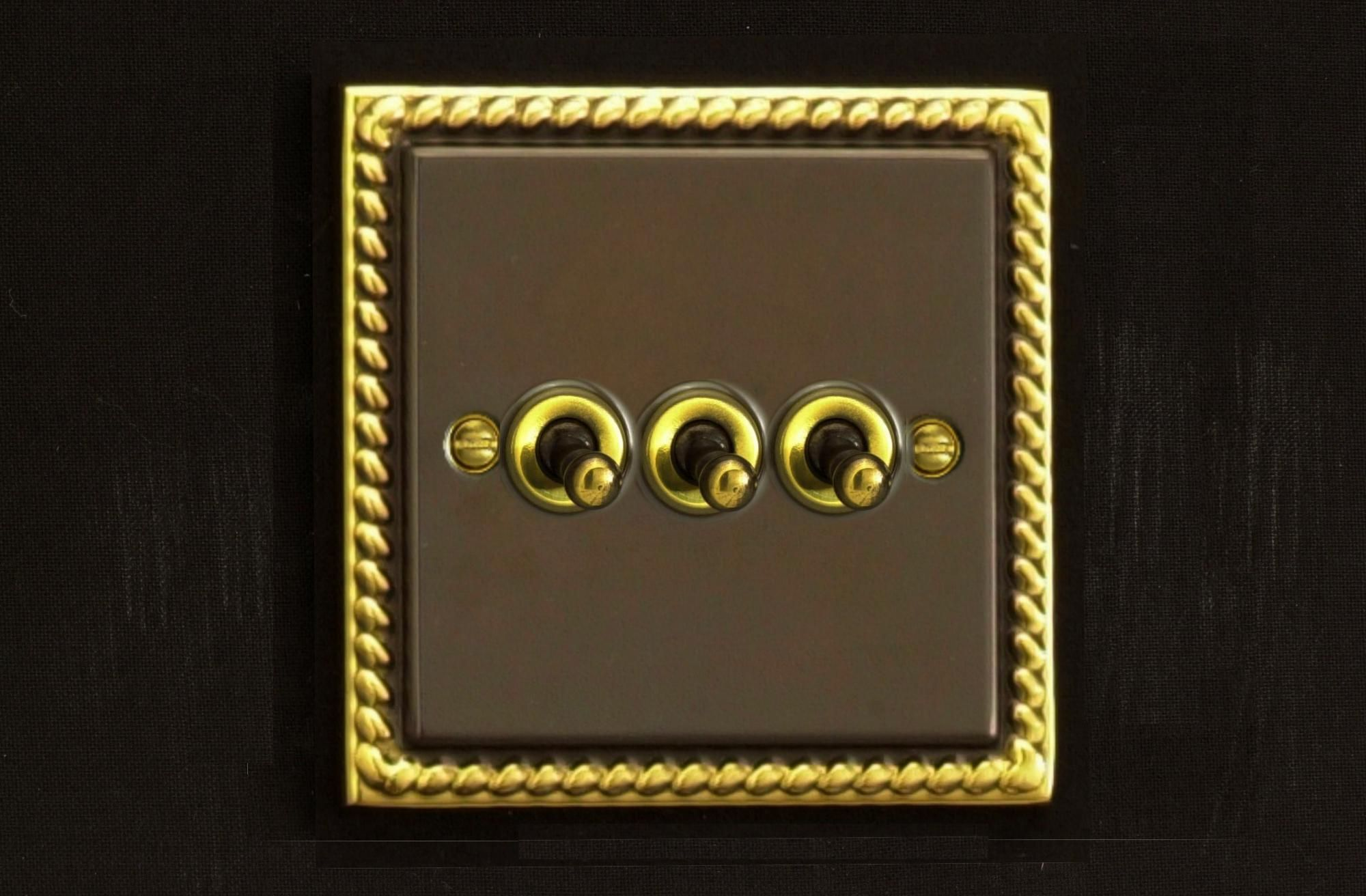 Varilight 3 Gang 10a 1 Or 2 Way Dolly Toggle Light Switch Antique Brass Georgian Finish Xat3